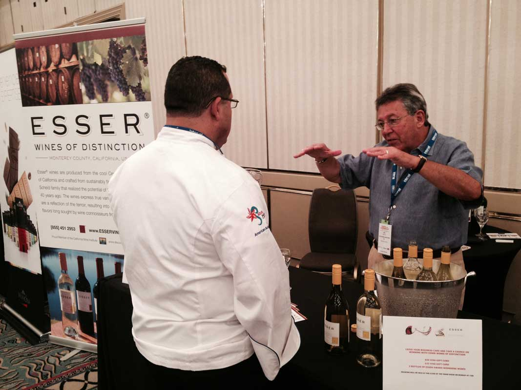Elvin Rosado, coach of the Puerto Rico Culinary Team listens intensely to Earl Myers while tasting Esser wines from Monterey, CA