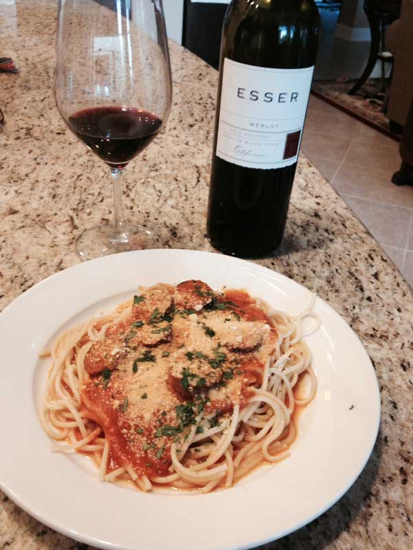 Pasta and homemade sausage with a great bottle of Esser Merlot