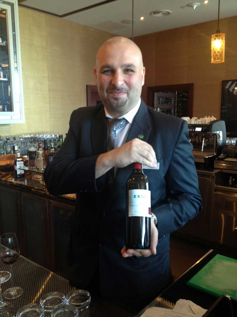 Michael Novak, Head Sommelier with Esser Merlot after selecting it for the wine list for their steak house Lexington Grill.