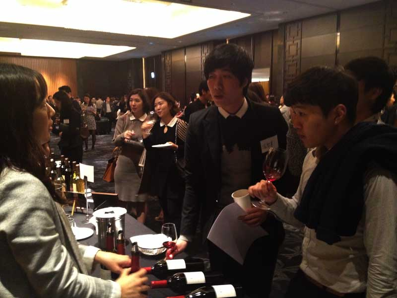 Jenny Park, Marketing Manager for Nara Cellars, pouring Esser Wines for consumers