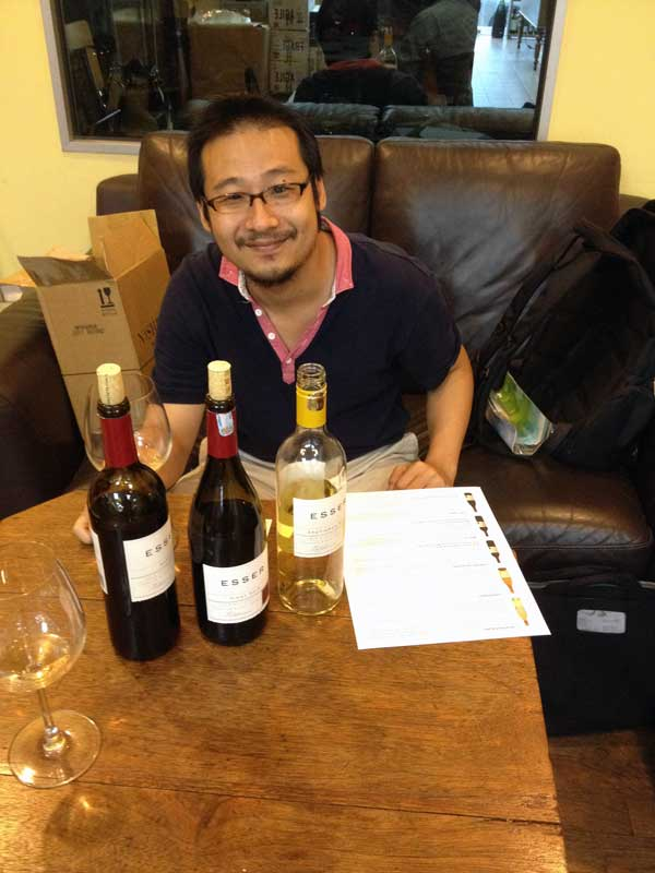 Paolo Tan, respected wine critic and retail store owner enjoying Esser Wines at his store in Kuala Lumpur