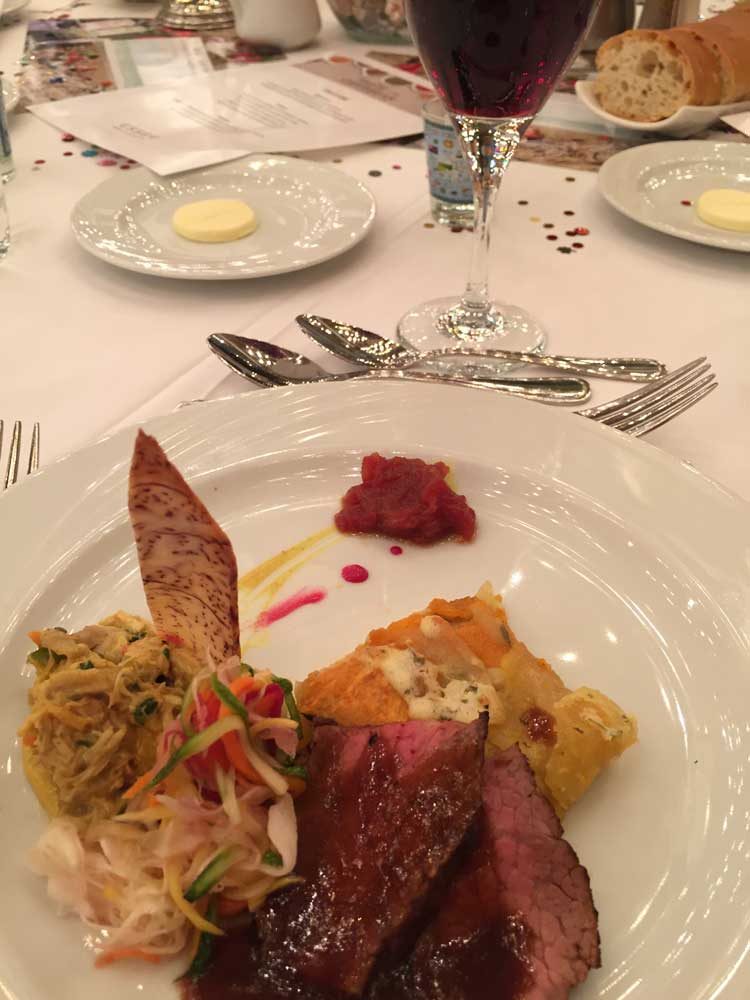 British Virgin Islands Presents Coconut Curry Chicken with tomato chutney along with applewood smoked Skirt Steak and Esser Pinot Noir