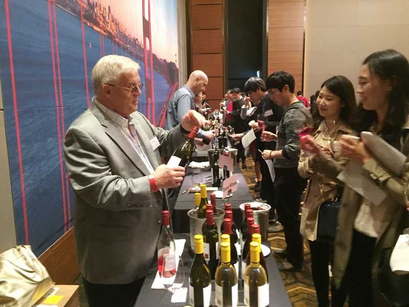 Peter Huwiler, pours another at a trade tasting in Seoul, South Korea